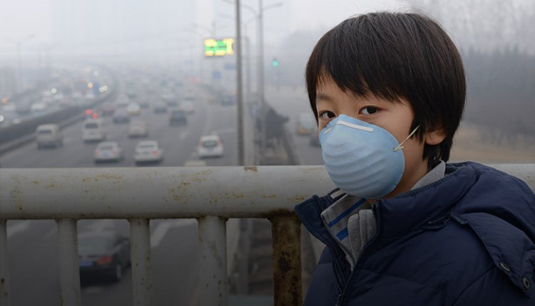 Boy wearing mask in air-polluted city